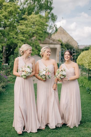 Bridesmaids in Blush Pink One Shoulder Dessy Bridesmaid Dresses | Outdoor Pastel Country Garden Wedding at Barnsley House in Cirencester | M and J Photography | Motion Farm Wedding Films