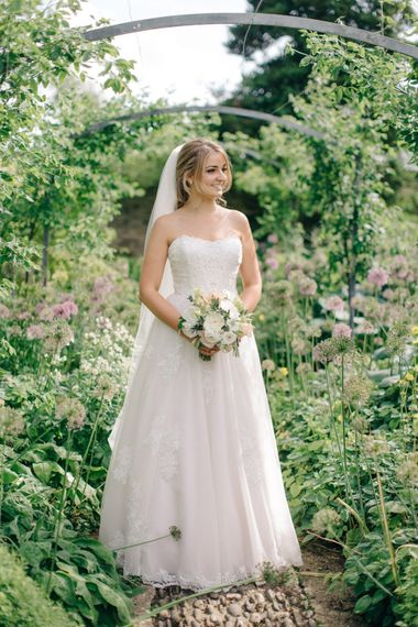 Beautiful Bride in Princess Gown | Outdoor Pastel Country Garden Wedding at Barnsley House in Cirencester | M and J Photography | Motion Farm Wedding Films