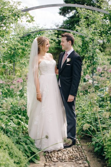Bride in Lace Princess Gown | Groom in Traditional Morning Suit | Outdoor Pastel Country Garden Wedding at Barnsley House in Cirencester | M and J Photography | Motion Farm Wedding Films