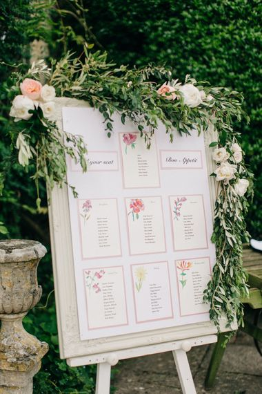 Table Plan with Floral Garland | Outdoor Pastel Country Garden Wedding at Barnsley House in Cirencester | M and J Photography | Motion Farm Wedding Films