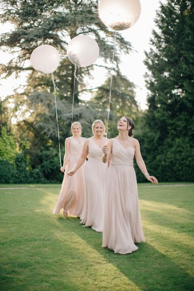 Giant Balloons | Bridesmaids in Blush Dessy Bridesmaid Dresses | Outdoor Pastel Country Garden Wedding at Barnsley House in Cirencester | M and J Photography | Motion Farm Wedding Films