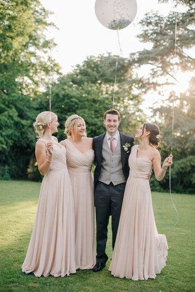 Groom in Traditional Morning Suit | Bridesmaids in Pink Dessy Dresses | Outdoor Pastel Country Garden Wedding at Barnsley House in Cirencester | M and J Photography | Motion Farm Wedding Films