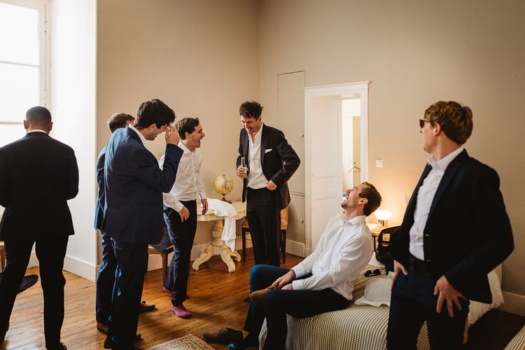 Groom and his men getting ready in South West France at Chateau de Lartigolle