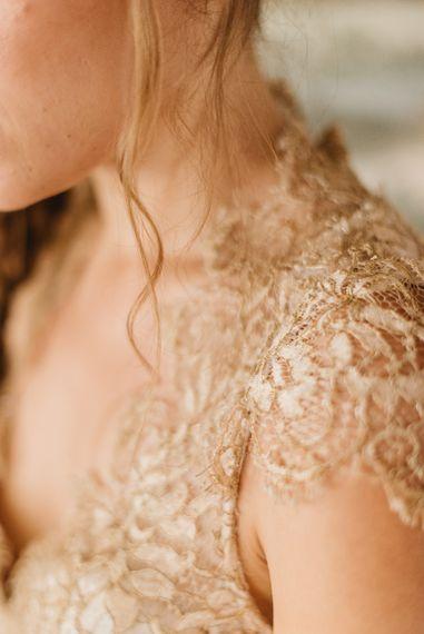 Gold lace Amanda Wakeley dress detail.