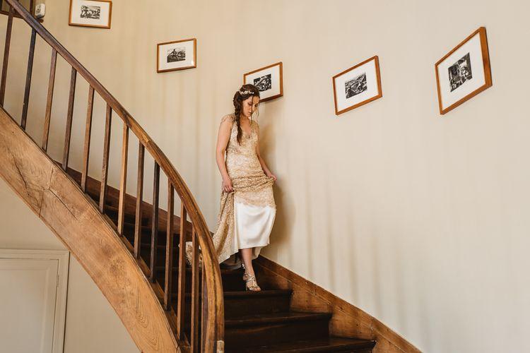 Gold Amanda Wakeley dress with stunning detail.
