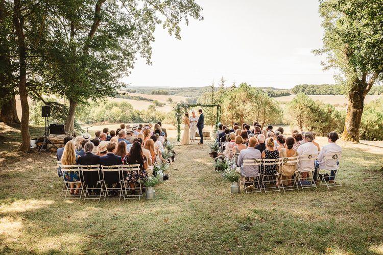 Idylic outdoor french wedding ceremony. Photography by Derek Smietana