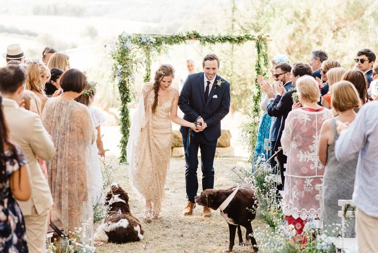 Floral wedding arch. Photography by Derek Smietana
