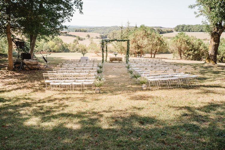 Wedding ceremony inspiration. White chair perfection.