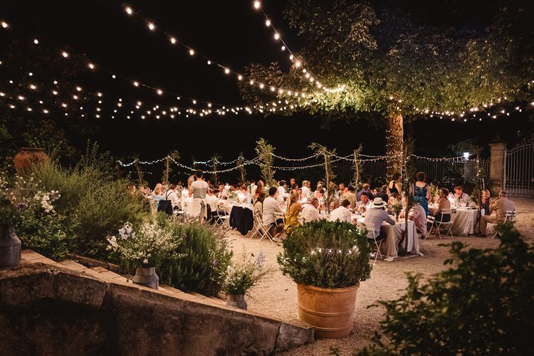 Fairy lit wedding in France at Chateau de Lartigolle. Photography by Derek Smietana