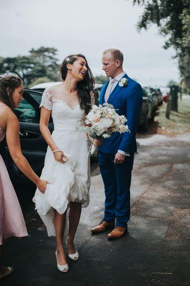 Bride Arrival in White Leaf Bridal Wedding Dress