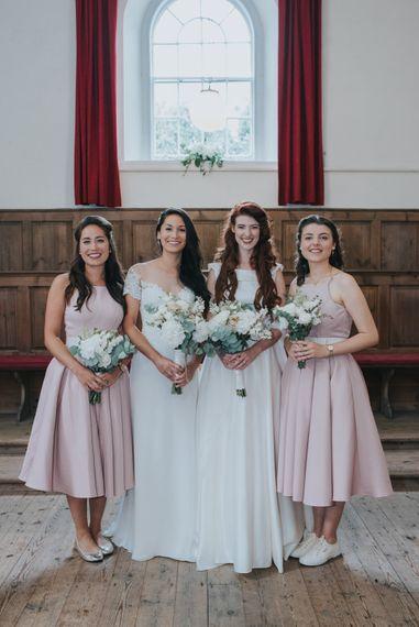Two Brides in Lou Lou Bridal Wedding Dress & White Leaf Bridal Wedding Dress | Bridesmaids in Blush Pink Chi Chi London Adele Dress