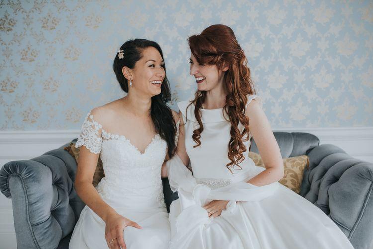 Two Brides in Ocean Bridal Studio Wedding Dress & White Leaf Bridal Wedding Dress