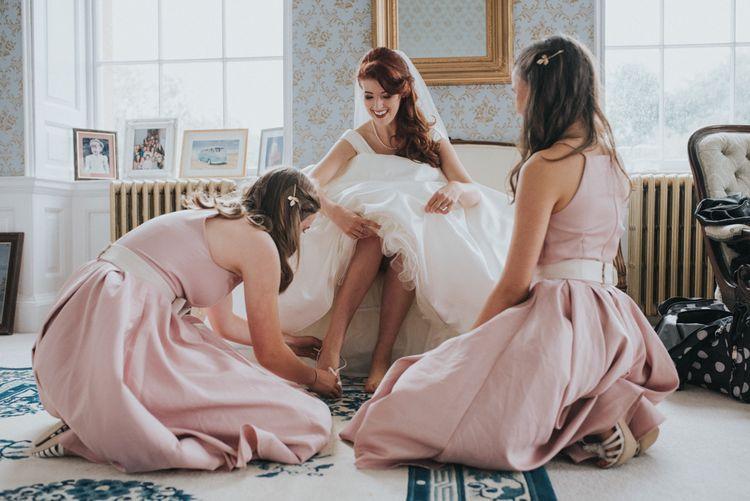 Two Brides in Ocean Bridal Studio Wedding Dress & Bridesmaids in Blush Pink Adele Chi Chi London Dresses