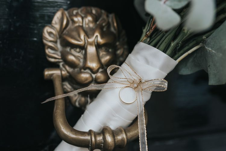 Gold Ribbon Wrapped Around the Bridal Bouquet