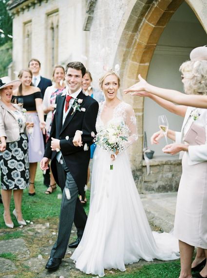 Confetti Exit   Bride in Suzanne Neville Camelia Gown   Groom in Traditional Tails   A Romantic Pastel Wedding at Dauntsey Park in the Wiltshire English Countryside   Imogen Xiana Photography