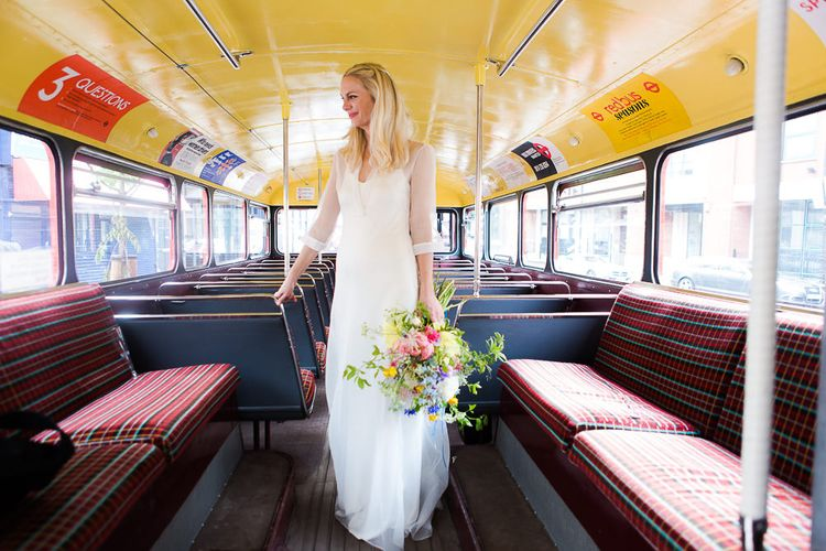 Red Routemaster Bus with Bride in Charlie Brear Wedding Dress & Bright Bouquet