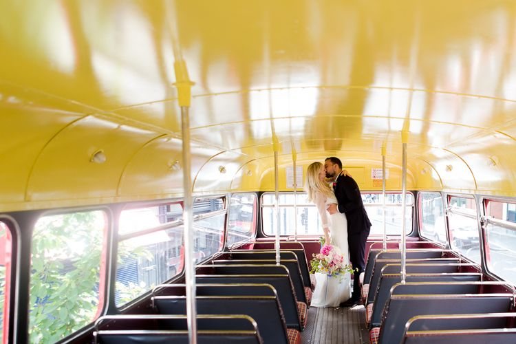 Red Routemaster Bus with Bride in Charlie Brear Wedding Dress, Bright Bouquet & Groom in Paul Smith Suit