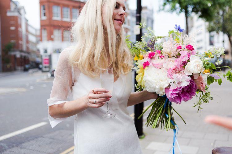 Bride in Charlie Brear Wedding Dress & Bright Bouquet