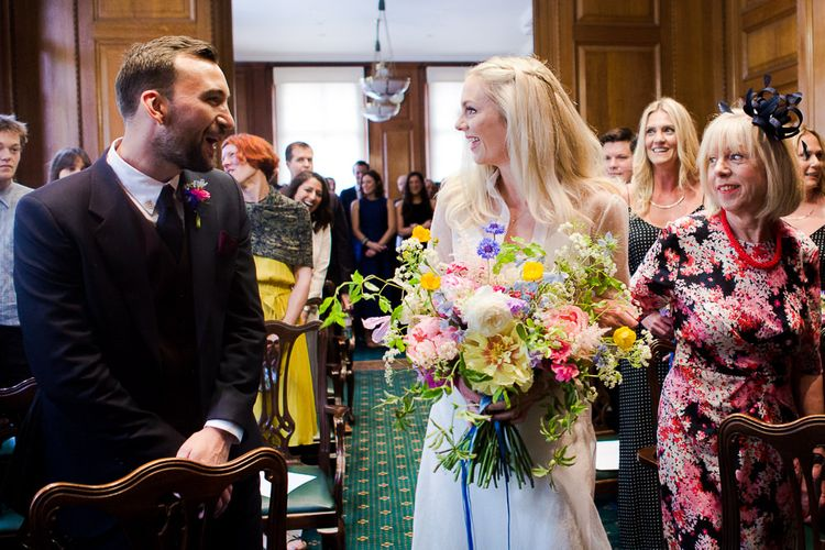 Camden Town Hall Wedding Ceremony with Bride in Charlie Brear Wedding Dress, Bright Bouquet & Groom in Paul Smith Suit