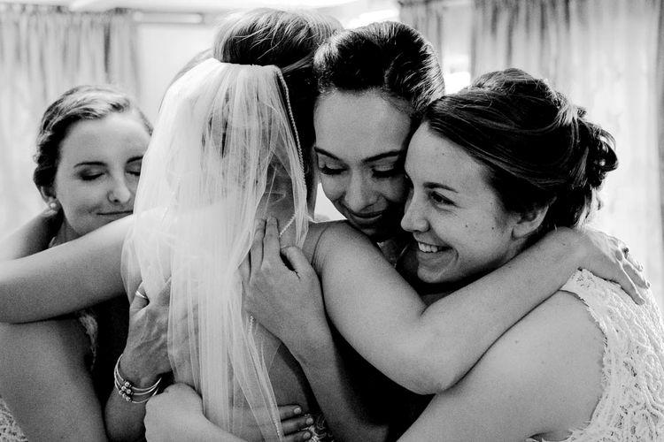 Bridal Party Hugs | Outdoor Ceremony at Boojum Tree in Phoenix, Arizona | Lee Meek Photography