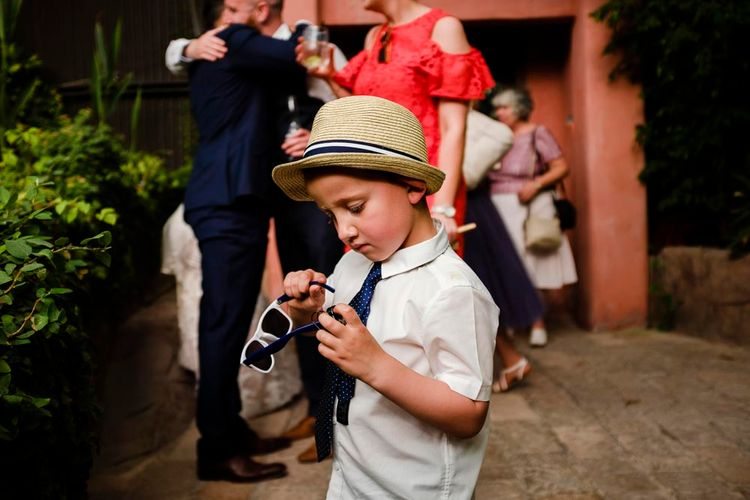Cool Ring Bearer in Trilby Hat | Outdoor Ceremony at Boojum Tree in Phoenix, Arizona | Lee Meek Photography