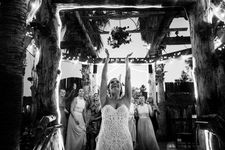 Bouquet Toss | Bride in Essense Designs Wedding Dress | Outdoor Ceremony at Boojum Tree in Phoenix, Arizona | Lee Meek Photography