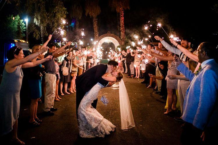 Sparkler Exit | Bride in Essense Designs Wedding Dress | Groom in Simon Dowling Bespoke Suit | Outdoor Ceremony at Boojum Tree in Phoenix, Arizona | Lee Meek Photography