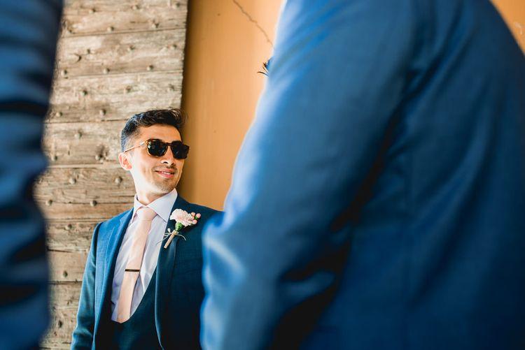Groom in Thom Sweeney Suit