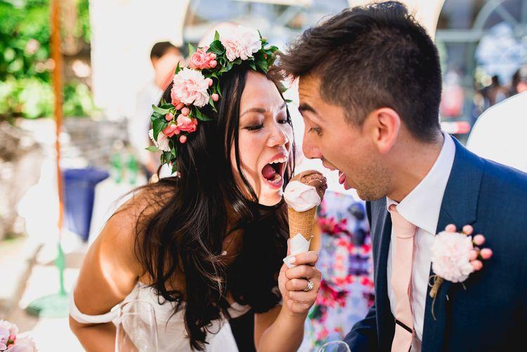 Bride in Tatyana Mereny Wedding Dress and Groom in Thom Sweeney Suit