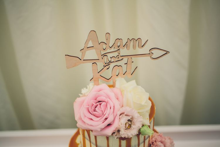 Gold Cake Topper For A Naked Wedding Cake With Drip Icing