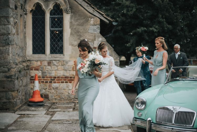 Bride in Pronovias White One Wedding Dress & Bridesmaids in Pale Green Claudia Ghost Dresses