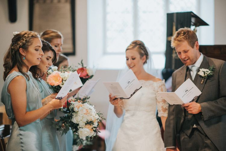 Church Wedding Ceremony with Bride in Pronovias White One Wedding Dress & Bridesmaids in Pale Green Claudia Ghost Dresses