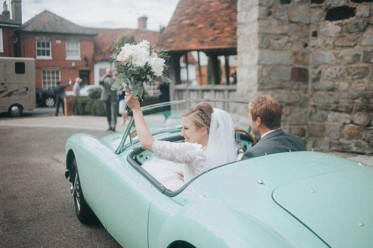 Vintage Wedding Car Exit with Bride in Pronovias White One Wedding Dress
