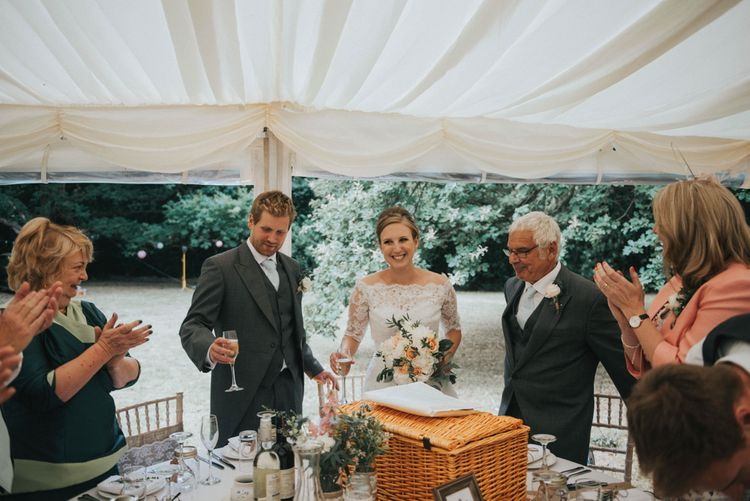 Bride in Pronovias White One Wedding Dress & Groom in Grey Morning Suit