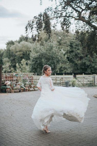 Bride in Pronovias White One Neive Wedding Dress