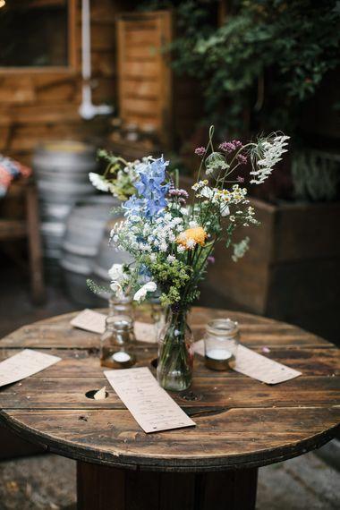 Wild Flower Table Arrangement & Kraft Paper Wedding Stationery