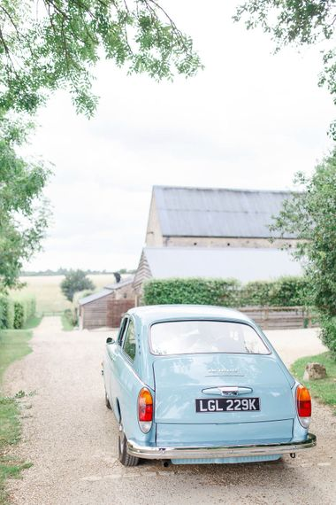 Blue Vintage Wedding Car | Romantic Pastel Wedding at Cripps Barn | White Stag Wedding Photography | Dan Hodge Wedding Films