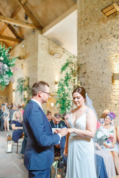 Barn Wedding Ceremony | Bride in Ellis Bridal Gown | Groom in Dyfed Menswear Navy Suit | Romantic Pastel Wedding at Cripps Barn | White Stag Wedding Photography | Dan Hodge Wedding Films