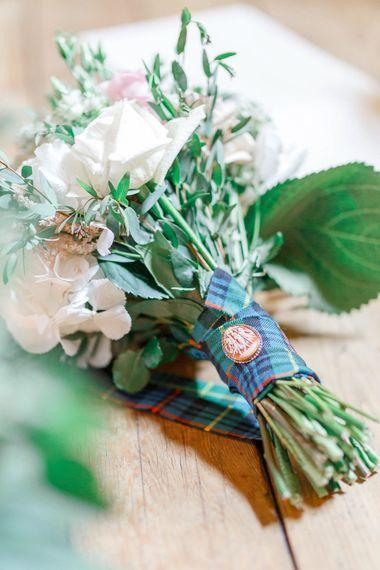 Tartan Ribbon & Cameo Brooch on Bouquet | Romantic Pastel Wedding at Cripps Barn | White Stag Wedding Photography | Dan Hodge Wedding Films