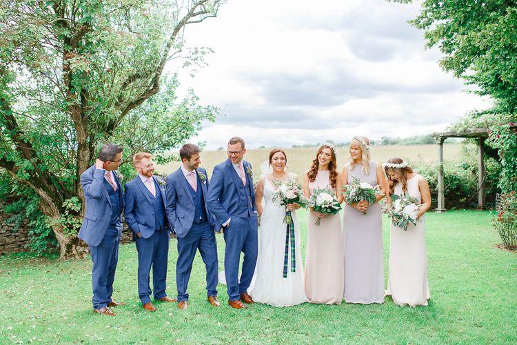 Wedding Party | Bride in Ellis Bridal Gown | Pink Hued ASOS Bridesmaid Dresses | Groomsmen in Dyfed Menswear Navy Suits | Romantic Pastel Wedding at Cripps Barn | White Stag Wedding Photography | Dan Hodge Wedding Films