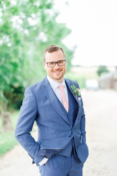 Groom in Dyfed Menswear Navy Suit | Romantic Pastel Wedding at Cripps Barn | White Stag Wedding Photography | Dan Hodge Wedding Films