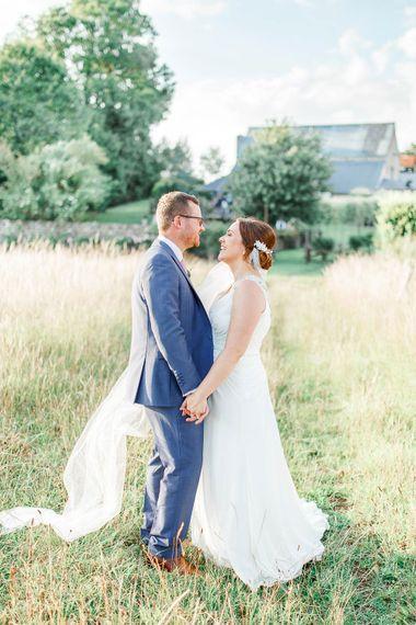 Bride in Ellis Bridal Gown | Groom in Dyfed Menswear Navy Suit | Romantic Pastel Wedding at Cripps Barn | White Stag Wedding Photography | Dan Hodge Wedding Films