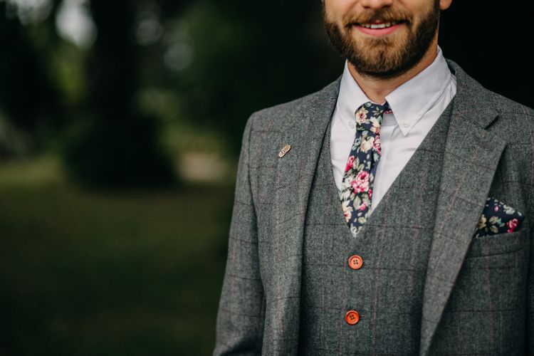 Groom In Grey Suit With Floral Tie // Outdoor Stretch Tent Wedding With Italian Antipasti Feast And Hay Bale Seating With Images From Ania Ames Wedding Photography