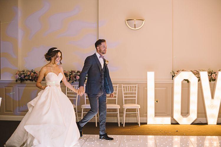 Dance Floor Lights | Bride in Ronald Joyce Bridal Gown | Groom in Grey Moss Bros Suit | The Orangery Maidstone | Lucie Watson Photography | TDH Media Films