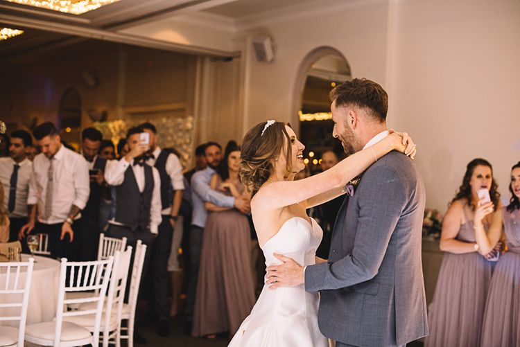 First Dance | Bride in Ronald Joyce Bridal Gown | Groom in Grey Moss Bros Suit | The Orangery Maidstone | Lucie Watson Photography | TDH Media Films
