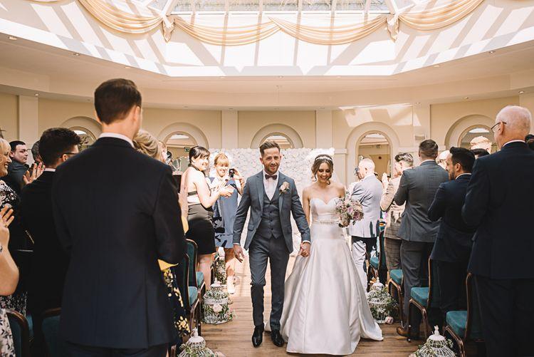 Wedding Ceremony | Bride in Ronald Joyce Wedding Dress | Groom in Grey Moss Bros Suit | The Orangery Maidstone | Lucie Watson Photography | TDH Media Films