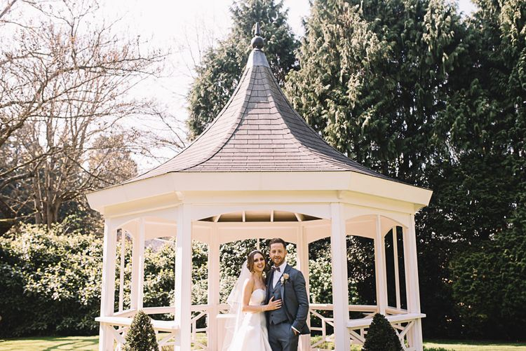 Bandstand | Bride in Ronald Joyce Wedding Dress | Groom in Grey Moss Bros Suit | The Orangery Maidstone | Lucie Watson Photography | TDH Media Films