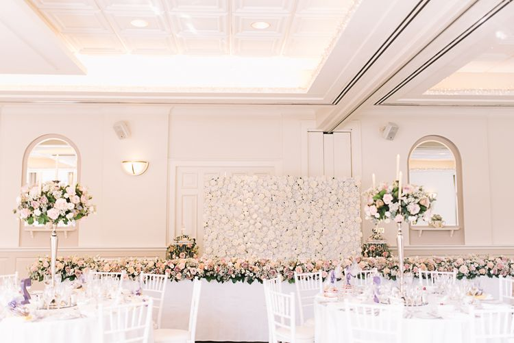 Flower Wall | Top Table Floral Table Runner | Candelabra & Flower Table Centrepieces | The Orangery Maidstone | Lucie Watson Photography | TDH Media Films