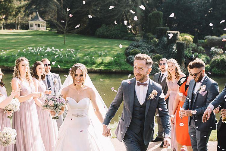 Confetti | Bride in Ronald Joyce Wedding Dress | Groom in Grey Moss Bros Suit | The Orangery Maidstone | Lucie Watson Photography | TDH Media Films