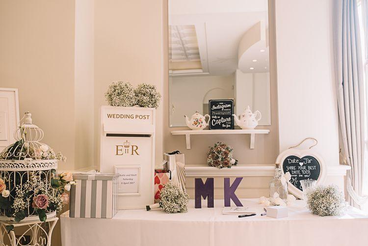 Wedding Decor | Bride in Ronald Joyce Wedding Dress | Groom in Grey Moss Bros Suit | The Orangery Maidstone | Lucie Watson Photography | TDH Media Films